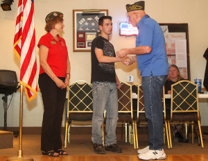 VFW Commander Joan McDermott and Frank Emery thank PFC Erik Garza for his service Saturday morning during a Welcome Home celebration at the American Legion.