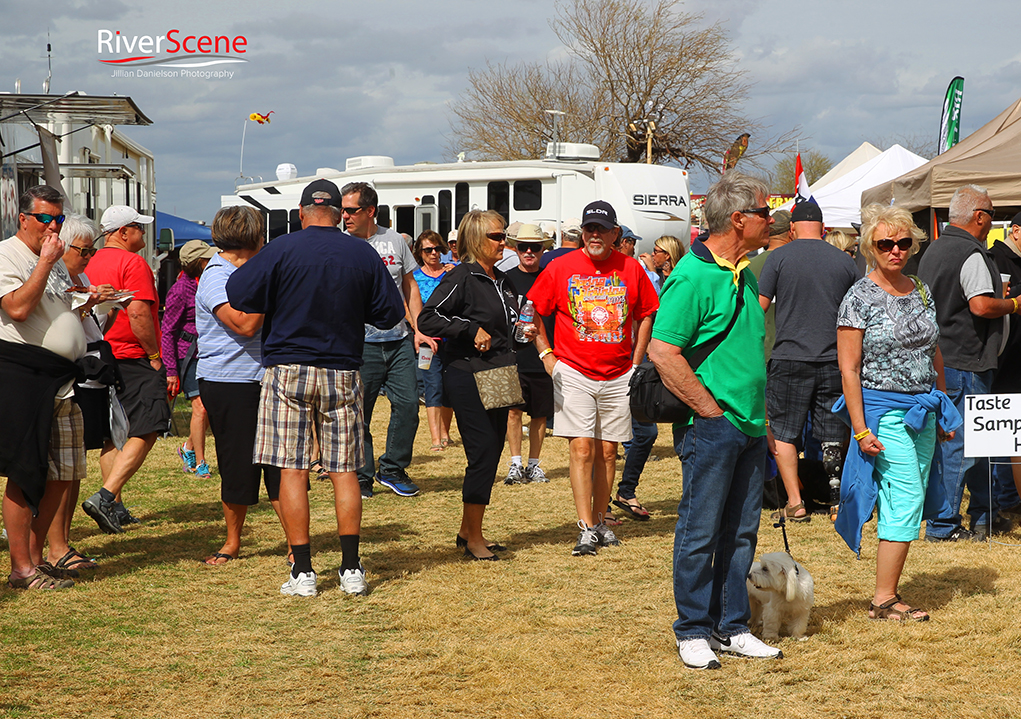 BBQ enthusiasts walk around getting samples at the Music Brews and BBQ Saturday afternoon.