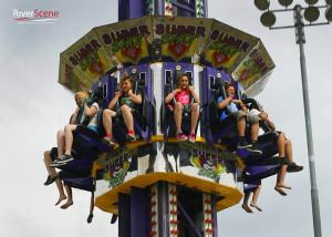 Students ride a carnival ride at the 2014 Teen Break. Jillian Danielson/RiverScene