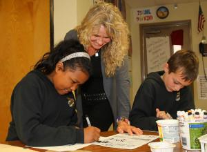 Pam works with students  Aisha Osman and A.J. Yahn on their Zen Doodles. Jillian Danielson/RiverScene