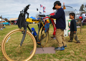 Jeff and Jake Stone look over a bike Saturday morning, that was  built by one of the elementary schools for the Bike Build Off. Jillian Danielson/RiverScene