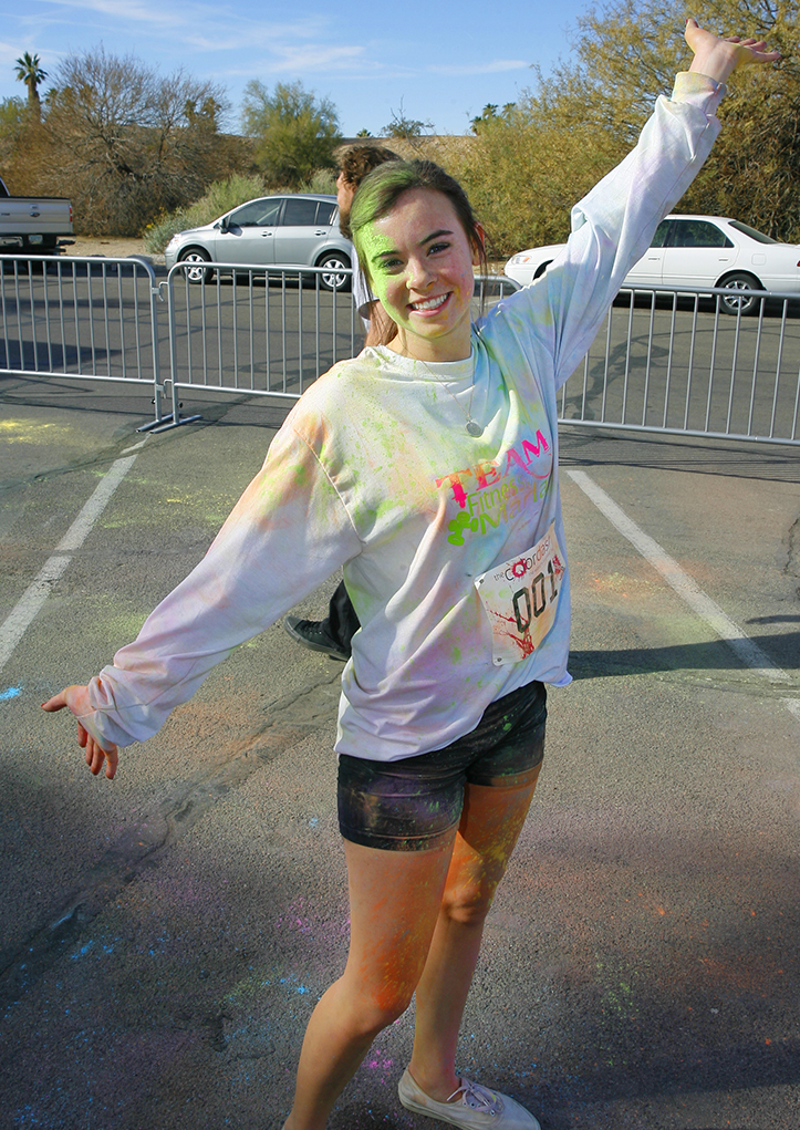 Mandi Gall shows off her shirt decorated in colored power from the Color Dash. Jillian Danielson/RiverScene