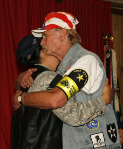 Dave thanks a woman for her service during a Welcome Home mission at the VFW. Jillian Danielson/RiverScene
