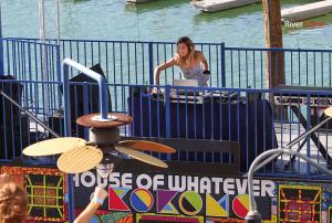 DJ Chelsea plays for a crowd at Kokomo Monday afternoon. Jillian Danielson/RiverScene