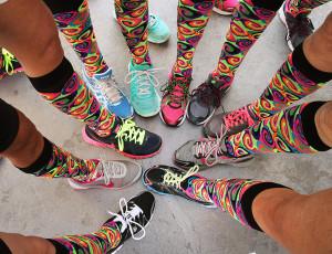 Team JLK Fitness show off their colorful socks at the Scavenger Hunt. Jillian Danielson/RiverScene