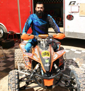 Michael Ellsworth sits on his quad outside of his trailer. Ken Gallagher/RiverScene