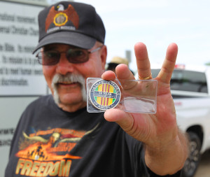 Wendall Shirk displays his coin that he received at the bbq. Jillian Danielson/RiverScene