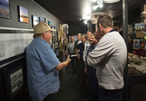 Jan Kasis gives a tour of the Visitor's Center under the London Bridge Wednesday afternoon. Mark Russell/RiverScene
