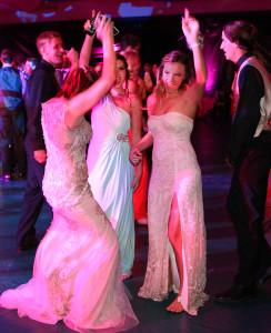 Makenzie Bourlier, Kaylee Kingston, and Mandi Gall dance at the Senior Prom Saturday evening. Jillian Danielson/RiverScene
