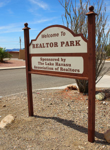 The sign for Realtor Park sits on Newport Drive. Parking is available along the street. Jillian Danielson/RiverScene
