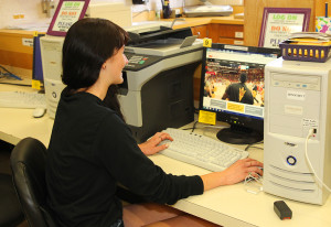 Jenna Van Rooy visits a college website looking for information. Jillian Danielson/RiverScene