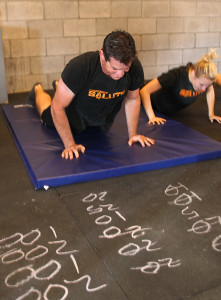 Nick Weiss does burpees Saturday morning to raise money for Taylor Coke. Jillian Danielson/RiverScene