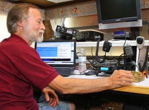 Doug Tebo demonstrates Morse Code Saturday afternoon during Field Day. Jillian Danielson/RiverScene
