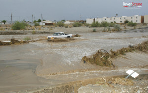 A pickup drives through a wash on Lake Havasu Avenue during a monsoon storm on July 13, 2012. Jillian Danielson/RiverScene