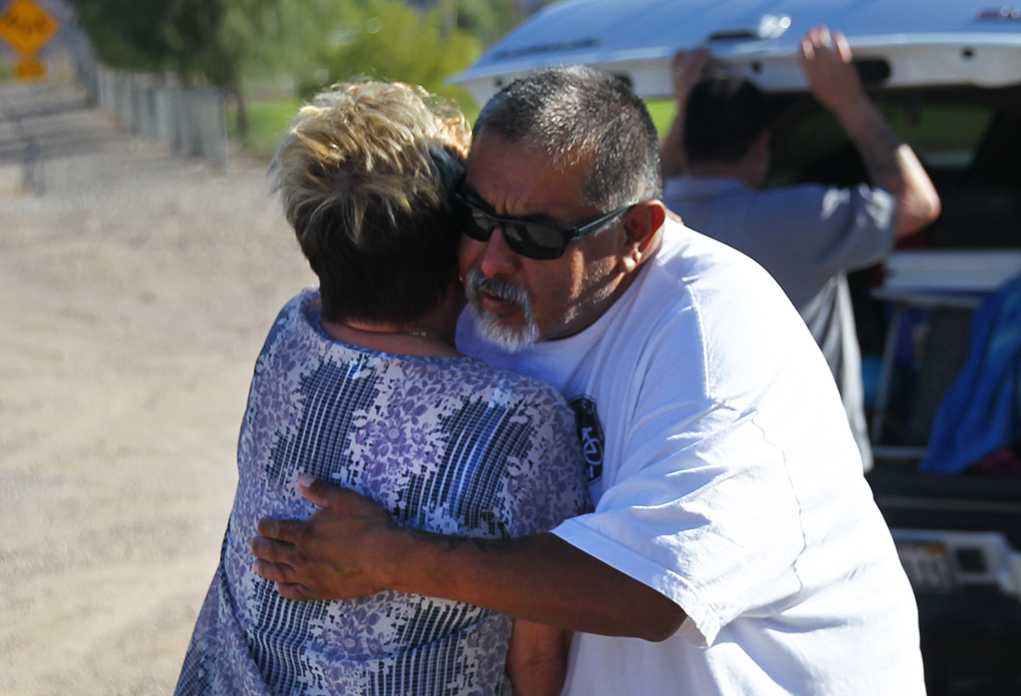 Linda Rosetta hugs Anthony Martinez after he arrives to place the bikes along Highway 95. Rosetta has also lot her own son in law to a cycling accident a year ago. Jillian Danielson/RiverScene