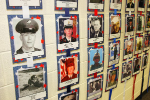 Photos hang on display  for the Wallof Honor. Jillian Danielson/RiverScene
