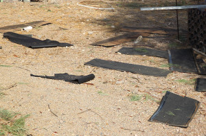 Shingles from the roof that were ripped off due to a microburst lay on the ground Friday morning. Jillian Danielson/RiverScene
