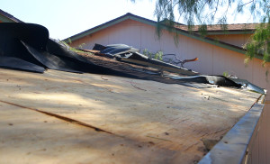 The roof is exposed after a microburst  on Thursday evening took off shingles from the roof. Jillian Danielson/RiverScene