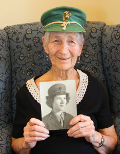 Roz Naylor at 93 years old, holding a photo of herself when she enlisted in the Marine Corps League at age of 20. Jillian Danielson/RIverScene