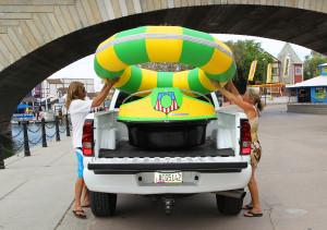 Chad and Jennifer Whetten remove a bumper boat from a truck to place it in the Bridgewater Channel. Jillian Danielson/RiverScene