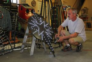 David Jones tests out lights in his garage for his Christmas display. Jillian Danielson/RiverScene