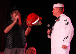 Craig Newton presents Uncle Si with a helmet signed by firefighters. Jillian Danielson/RiverScene
