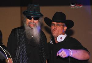 Uncle Si and DJ Boom Bandit Jason Kleefisch pose for a photo Friday evening. Jillian Danielson/RiverScene