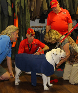 Bill Stephens, Eddie Dunn and Gene Burns watch Max get fitted with the uniform that Karen Chavez is sewing for him. Jillian Danielson/RiverScene