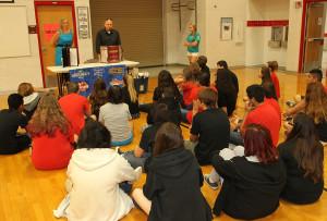 Representatives from Shugrues speak to 8th grade students Thursday morning. Jillian Danielson/RiverScene