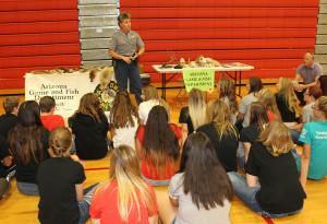 Deanna Pfleger of Arizona Game and Fish speaks to 8th graders Thursday morning. Jillian Danielson/RiverScene