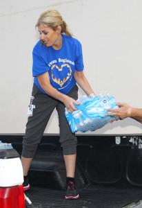 Keri Elias loads water at Havasu Regional Medical Center into a truck Tuesday morning. Jillian Danielson/RiverScene
