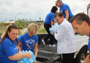 Hospital staff unload water at the food bank Tuesday morning. Jillian Danielson/RiverScene