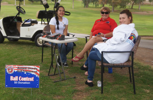 Marine Corps League Auxiliary member Patty Holder (center) monitors the 12th Hole with volunteers Chanelle Fernandez and Sabrina Louridas of Lake Havasu International Order of Rainbow for Girls. Judy Lacey/RiverScene