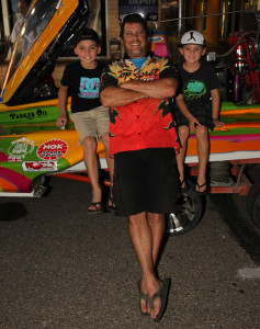 Driver Shawn Reed poses with Kaden and Kole Cesena for a photo Friday evening at Fan Fest. Jillian Danielson/RiverScene
