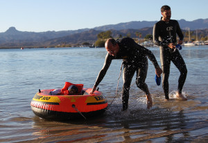 Timothy Bolen pulls Utitus-Canuz onto shore after swimming with him Saturday morning during HITS. Jillian Danielson/RiverScene