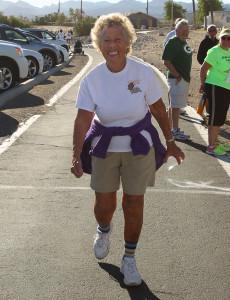 Norma King,88, crosses the finish line Saturday morning. Jillian Danielson/RiverScene