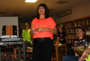 Mari Jo Mulligan, principal of Thunderbolt Middle School, tells the teachers that Thunderbolt is one of the nominations for the Capturing Kids' Hearts Award. Jillian Danielson/RiverScene