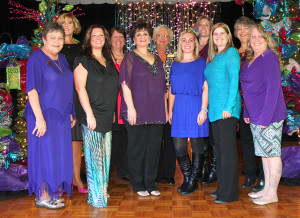 Women With Willpower board members pose for a photo at the Christmas Tree Raffle. Jillian Danielson/RiverScene