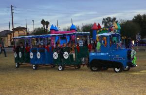Children enjoy a train ride Thursday evening. Jillian Danielson/RiverScene