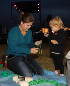 Nicole Alves helps Charlotte Alves make a beaded necklace Thursday evening. Jillian Danielson/RiverScene