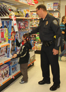 Evan Minert shops with Captain Rob Harry Saturday morning at Kmart. Jillian Danielson/RiverScene