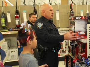Aden Ortiz shops with Chief Dan Doyle Saturday morning at Kmart. Jillian Danielson/RiverScene