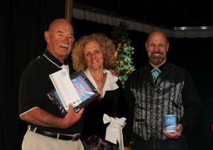 Buster Johnson presented the Grand Marshall Award to Dan Remy and Nan Rowden. Jillian Danielson/RiverScene