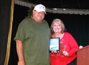 Tammy Kastelz presents the Best Individual/Family Award to Phil Hamner. Jillian Danielson/RiverScene