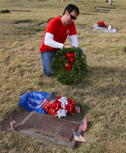 Cal Sheehy lays a wreath at the gravesite of Patrick Tinnell Monday morning. Jillian Danielson/RiverScene