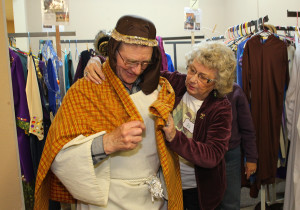 Violet Ledford helps Francis Duschl get ready for the dress rehearsal of the Drive Through Nativity Friday night. Jillian Danielson/RiverScene