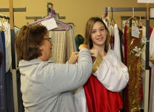 Cathy Cosgrove helps Lyla Chrusciel get ready for the Drive Through Nativity dress rehearsal Friday evening. Jillian Danielson/RiverScene
