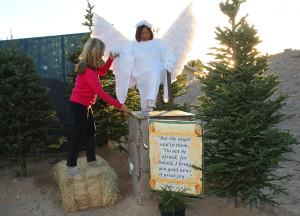 Carol McDougall assists Jheli Johnston onto a platform during a dress rehearsal for the Drive Through Nativity Friday evening. Jillian Danielson/RiverScene