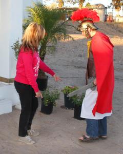 Carol McDougall assists Bradly Kuntz during the Drive Through Nativity rehearsal Friday evening. Jillian Danielson/RiverScene