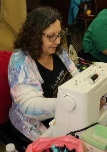 Pam Hennings sews Friday afternoon during Quilting By The Bridge. Jillian Danielson/RiverScene